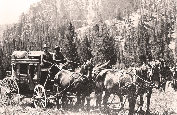 Stagecoach riders with shotguns for defense
