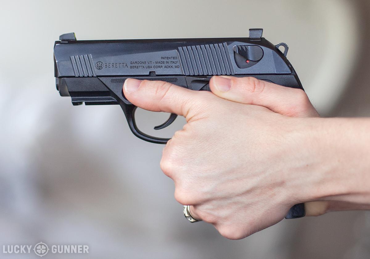 thumbs forward pistol grip
