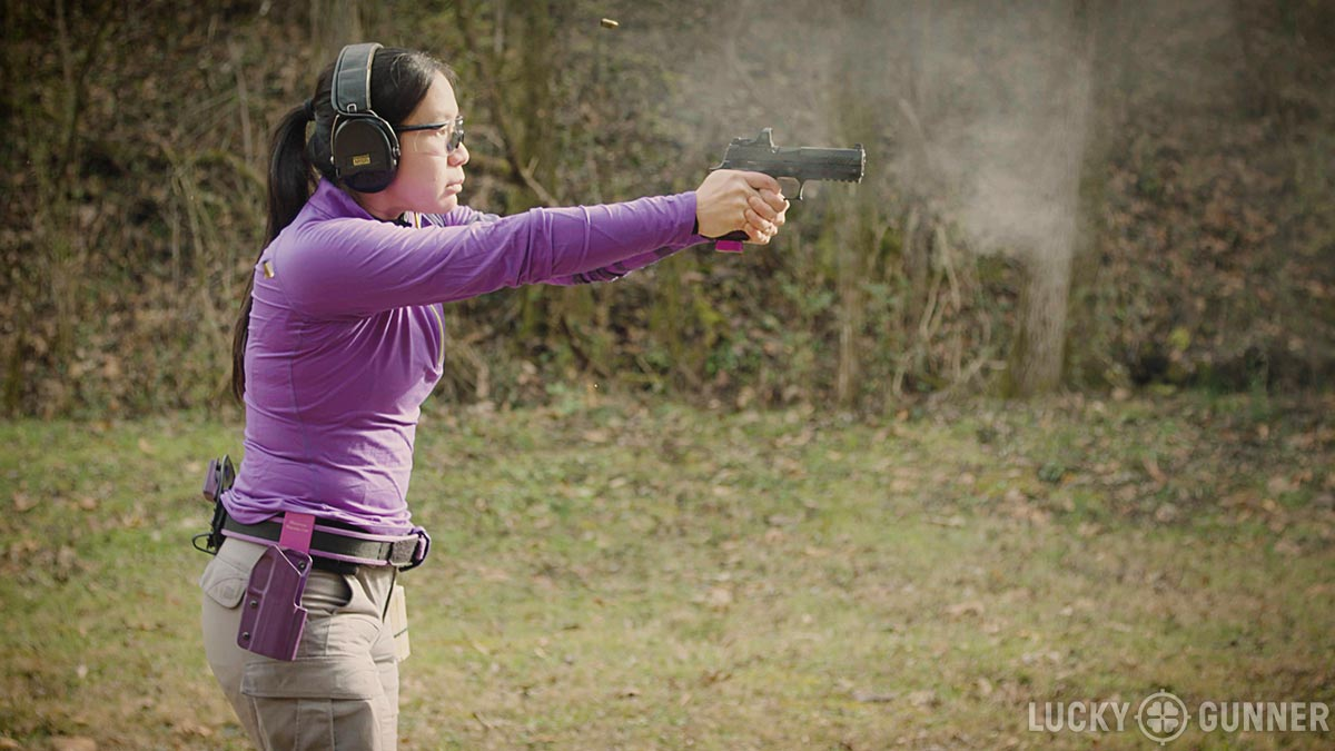 Annette Evans shooting at the range with Lucky Gunner
