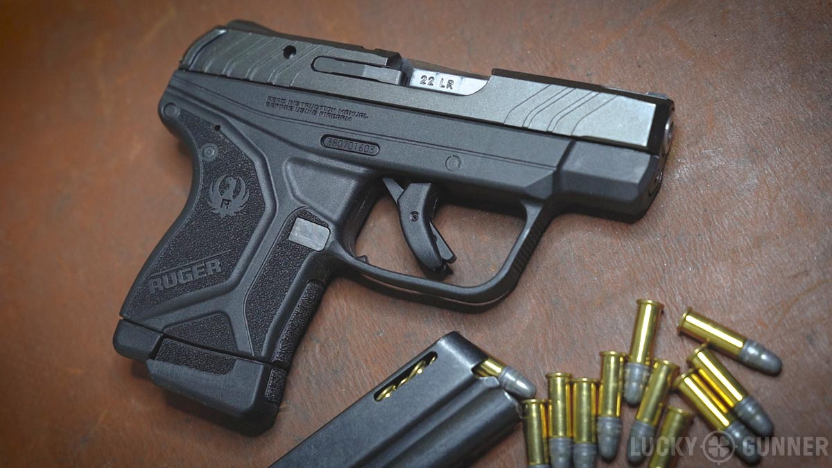 Ruger LCP II 22 lr review pistol with ammo and magazine
