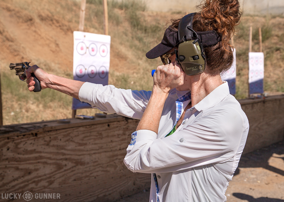 A student practicing a one-handed shooting flashlight technique at the Revolver Roundup.