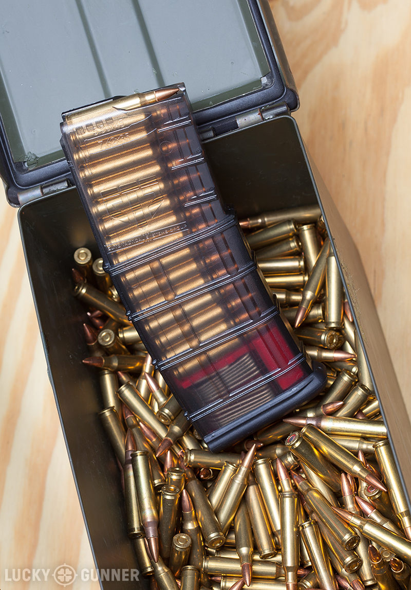 Metal military surplus ammo cans are good for storing either cartridges or loaded magazines. My approach is to place 6 30rd magazines, a full load, on top of enough boxed ammunition to replenish them.